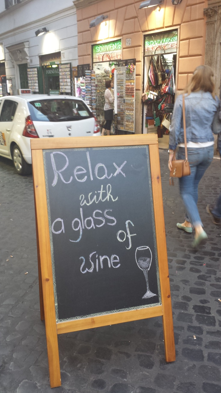 relax with a glass of wine sign in Rome