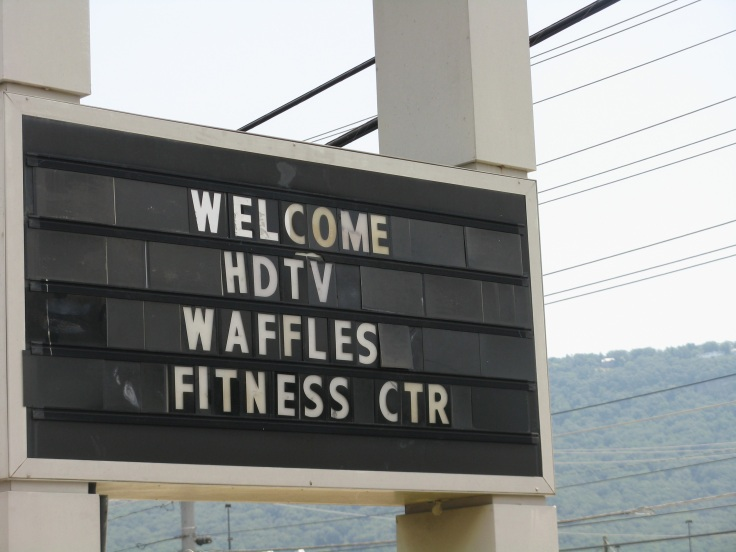 hotel sign HDTV, waffles, fitness center
