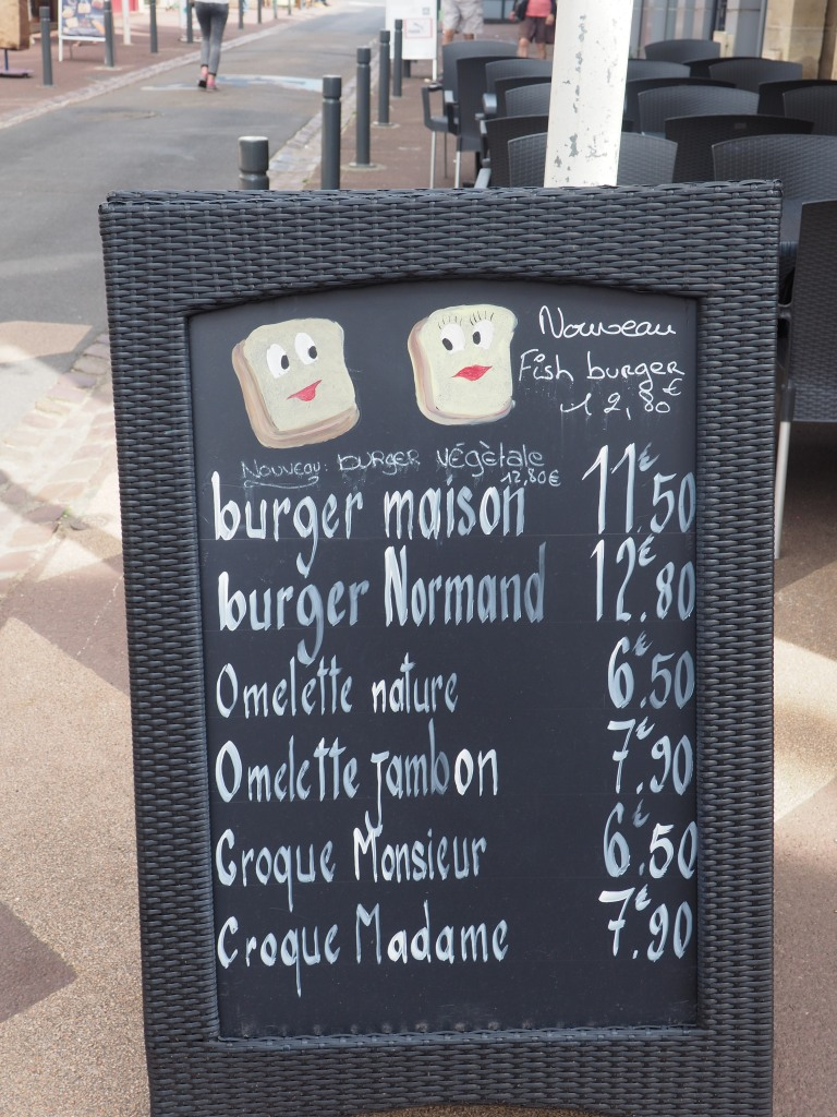 sidewalk sign at a Bayeux restaurant
