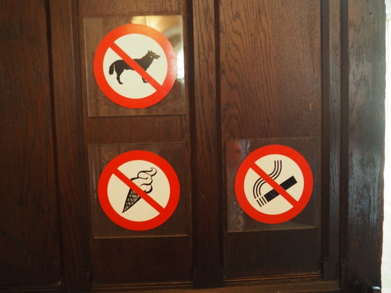 Bayeux Cathedral no dogs food cigarettes sign on door